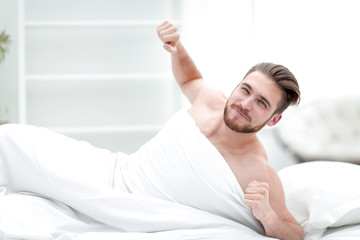 smiling man waking up in the morning