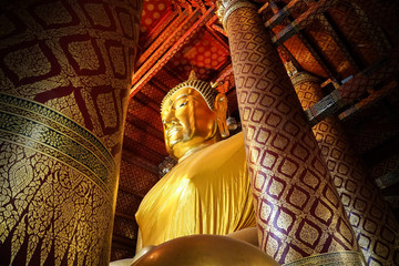 big gold buddha image statue at temple, Thailand