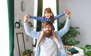 Father's day. Happy family daughter hugs his dad  .