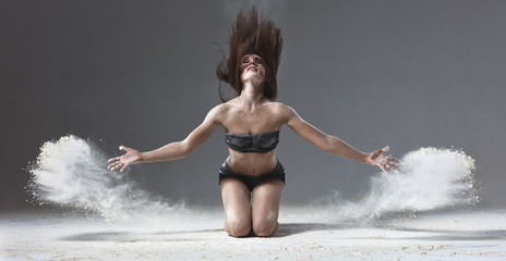 ballet dancer jumping with flour