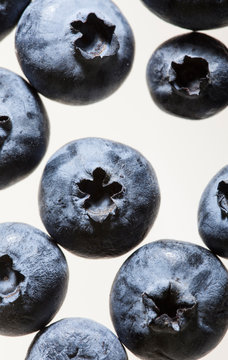 Macro view of blueberries on white