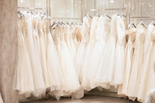Elegant dresses in the wedding salon. The choice of wedding dresses in the store