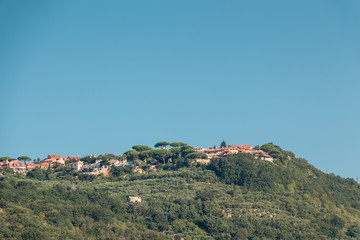 A small Italian village with green forest