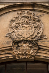 Old historical building with coats of arms made of stone