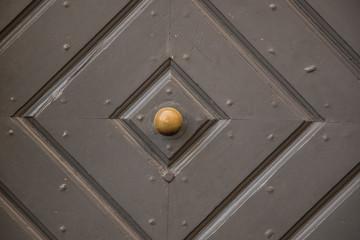 Old door of a historical building with iron door knob
