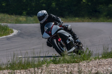 The sports motorcycle at high speed overcomes a sharp corner