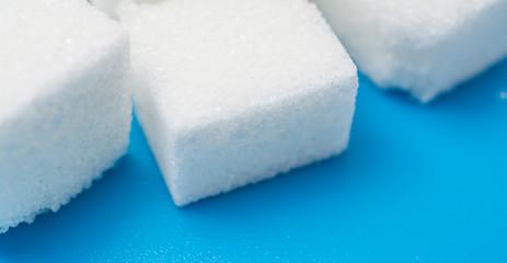 sugar close up over blue background
