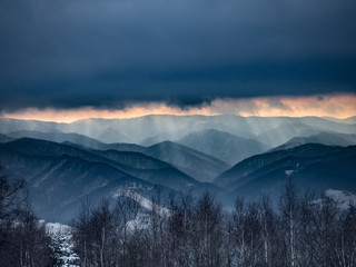 Heavy Clouds in Beskids Mountains in winter. Near Rytro Village, view from Mount Makowica. Poland.