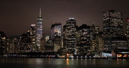 Fototapete - New York City night skyline buildings from sailing boat