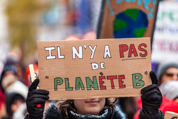 Activists marching for the environment. French sign seen in an ecological protest saying there is no planet B