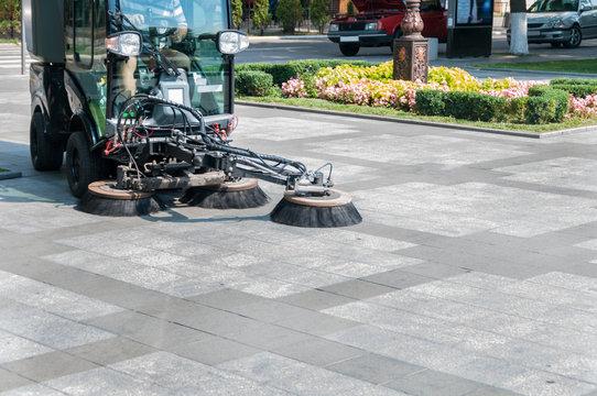 sidewalk cleaning machine in the park