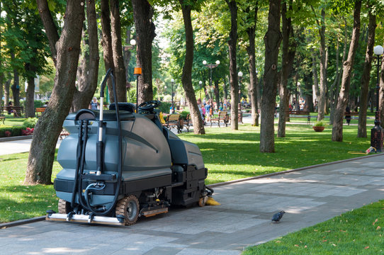 sidewalk cleaning machine in the park