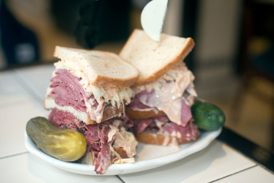 Kosher deli combination sandwich pastrami corned beef tongue cole slaw and Russian dressing