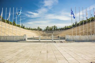 travel sightseeing touristic concept world heritage site of ancient stadium example of antique architecture, symmetry photography, Greek flags on pillars before enter