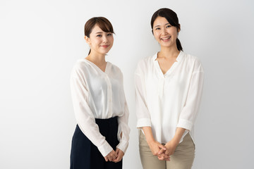 portrait of two young asian women on white background
