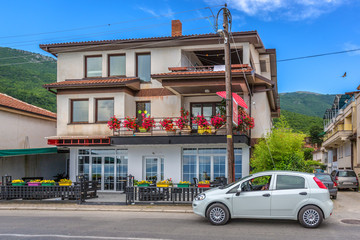 Ohrid, Macedonia - May 31st 2018 - A tourist car parking in front of a local house with flowers in the balcony in Macedonia