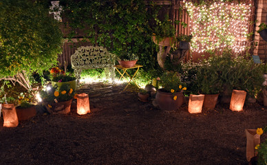 Nightly garden with bench and luminaria lights