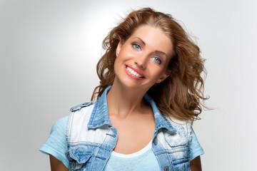 beautiful happy girl in blue jeans jacket