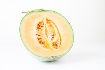 A half orange melon or Japanese melon on white background