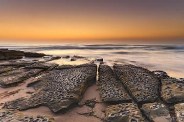 Beach Rock Ledge and Sunrise Seascape