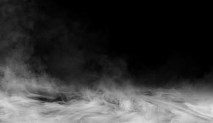 Smoke on the floor . Isolated black background.