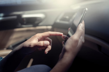 Smart Phone  In Hand's Hold For Shopping Online In The Car , Concept Freedom