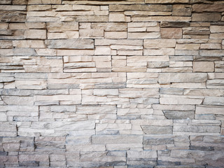 Close up of a grey modern stone brick wall used for background