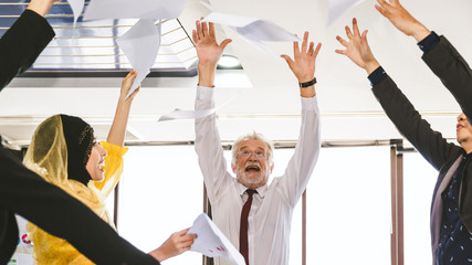 Group of business throw papers fly in air