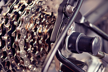 close up of  bicycle gear and black electric motor