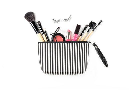 Make up bag with various cosmetics and brushes isolated
