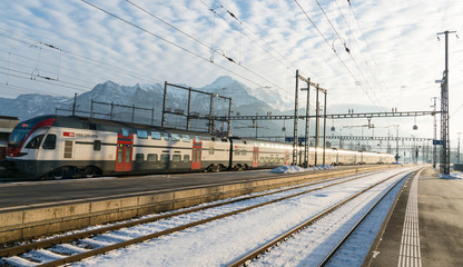 January 4, 2019 - Sargans, SG, Switzerland: train station in Sargans, Switzerland, in winter after clean up work with a modern SBB train departing the station on time
