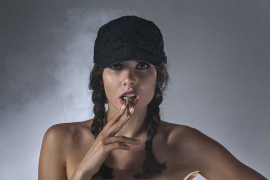 Young woman with hand-rolled cigarette