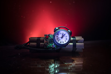 Image of a time bomb against dark background. Timer counting down to detonation illuminated in a shaft light shining through the darkness,