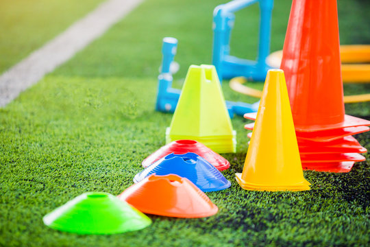 soccer training equipment on green artificial turf