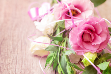Pink flowers on wooden background. Concept for greetings card.