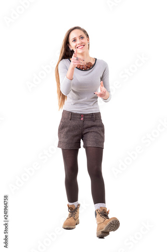 cc3feaac8ccbf Candid stylish beautiful hipster girl smiling and pointing finger at  camera. Full body isolated on white background.