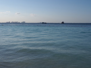 Panoramic view of quiet turquoise waters of Caribbean Sea landscape with horizon line at Cancun city in Mexico