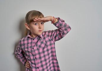 little girl grimacing on white background