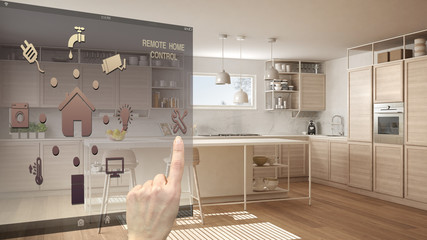 Smart home control concept, hand controlling digital interface from mobile app. Blurred background showing modern white and wooden modern kitchen, architecture interior design