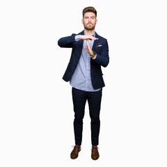 Young handsome bussines man Doing time out gesture with hands, frustrated and serious face