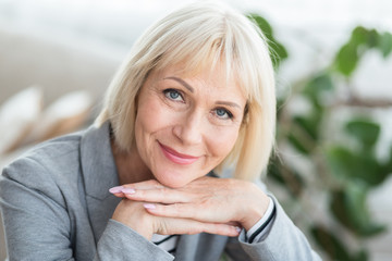 Lovely middle-aged blond woman with beaming smile