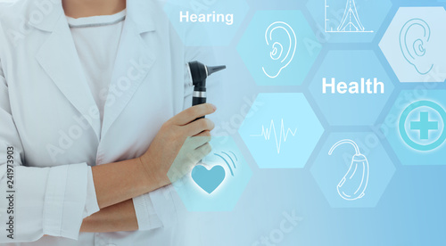 Ear doctor with otoscope in hand and hearing, medical icons on