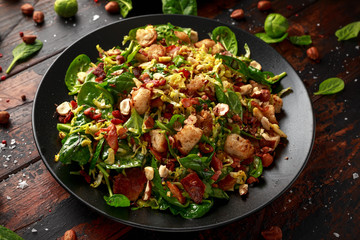 Poster Brussels Roasted brussel sprouts, bacon warm salad with spinach, croutons and hazelnuts