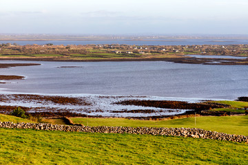 Farms in the Burren with Galway bay in background