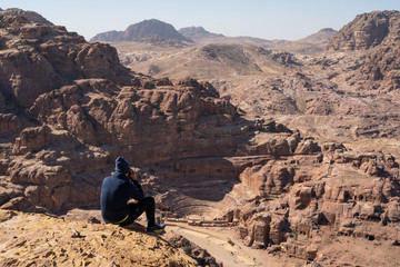 Tourist take picture and enjoy view of Roman theater in Petra ancient city, Jordan