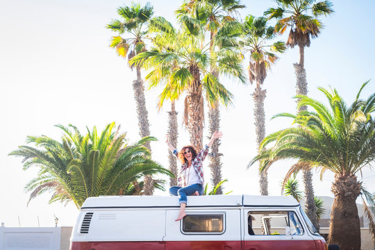 Happiness attitute for middle age cheerful nice woman enjoying travel with old red vintage van in tropical place for vacation or wanderlust lifestyle - trend transport vehicle concept