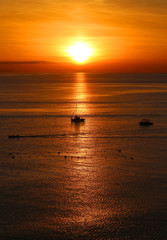 Photo of sea sunset with a boat