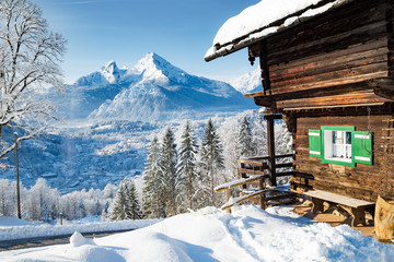 Winter scenery with mountain hut in the Alps