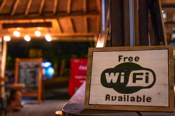 Free wifi sign wooden board in restaurant of Bali island, Indonesia.