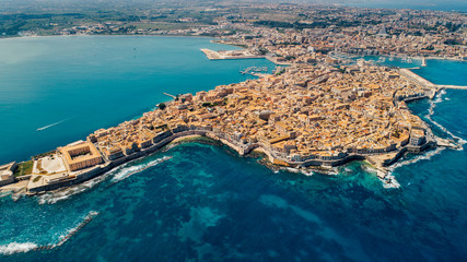 Aerial panoramic view of Ortigia island,old town of Syracuse.Small island on Sicily,Italy.Sicilian vacation,charming Italian experience.Beautiful seaside landscape Fototapete